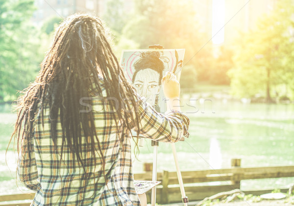 Artist girl painting self-portrait in city lake park outdoor - Y Stock photo © DisobeyArt