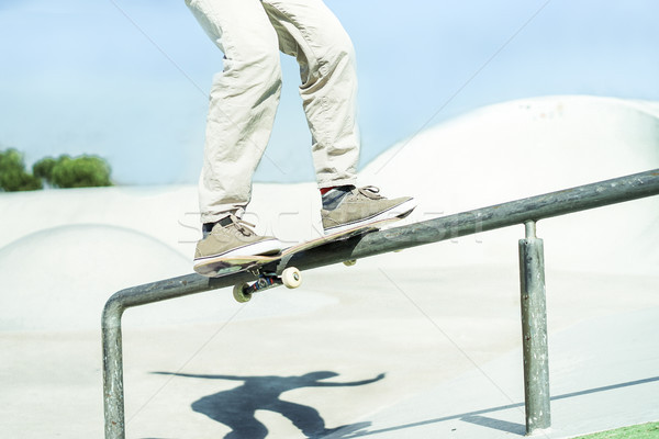 Skateboarder performing trick on railing in skate city park - Yo Stock photo © DisobeyArt