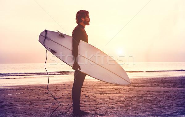 Uomo surfer tavola da surf sunrise Foto d'archivio © DisobeyArt
