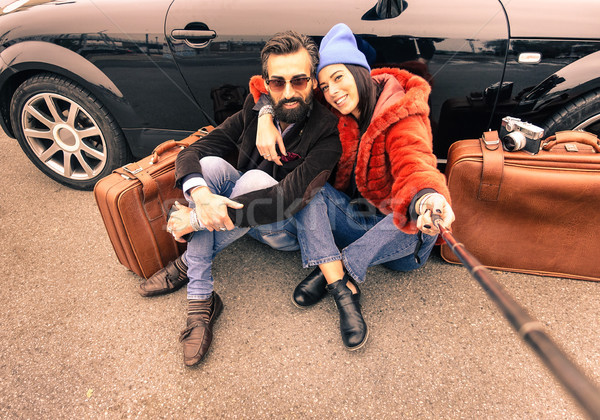Stock photo: Hipster couple making selfie with stick  - Travel and fashion li