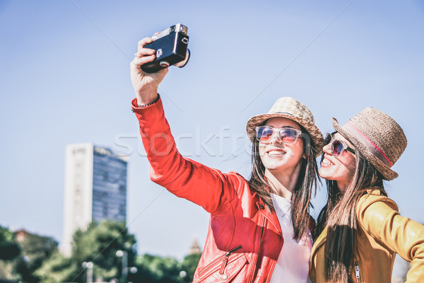 Best friends make selfie photo with old retro camera while trave Stock photo © DisobeyArt