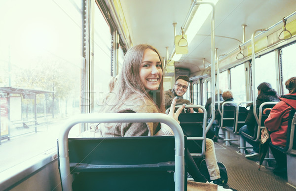 Young people inside old style tram - Happy passengers having fun Stock photo © DisobeyArt