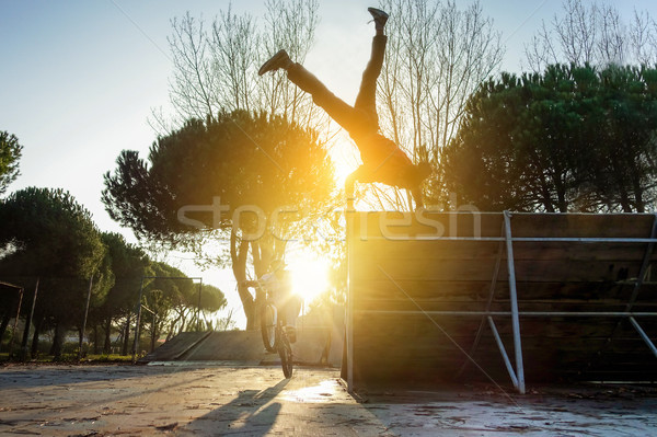 Friends performing freestyle biking and breakdancing at the same Stock photo © DisobeyArt