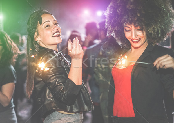 Young women making party with fireworks inside night club - Tren Stock photo © DisobeyArt
