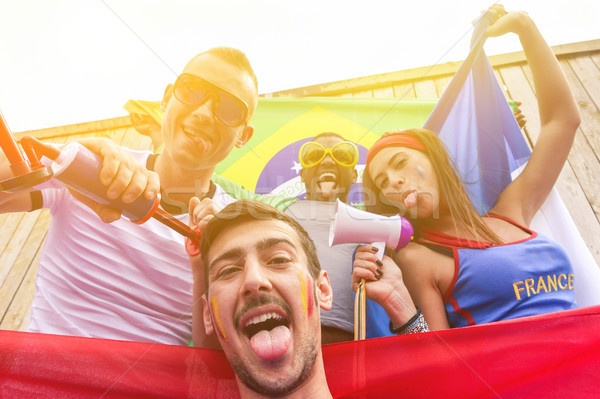 Multinational football supporters in Brazil for sport games with Stock photo © DisobeyArt