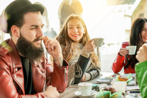 Happy hipster people drinking cappuccino and eating muffins - Yo Stock photo © DisobeyArt