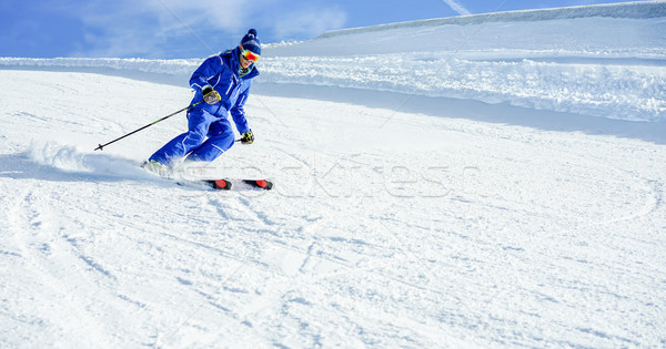 Young athlete skiing in Deux Alps french mountains on sunny day  Stock photo © DisobeyArt