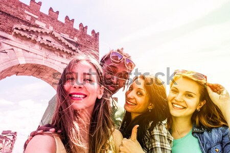 Happy friends taking selfie at powders holi colors festival - Yo Stock photo © DisobeyArt