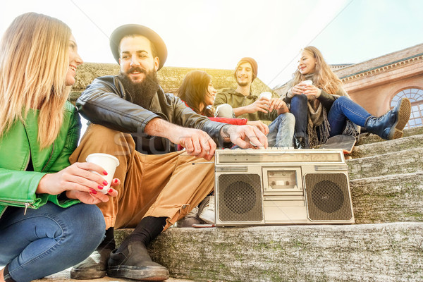 Group of hipster friends drinking cappuccino and listening music Stock photo © DisobeyArt