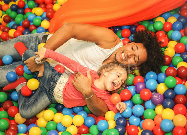 Young father playing with his daughter inside ball pit swimming  Stock photo © DisobeyArt