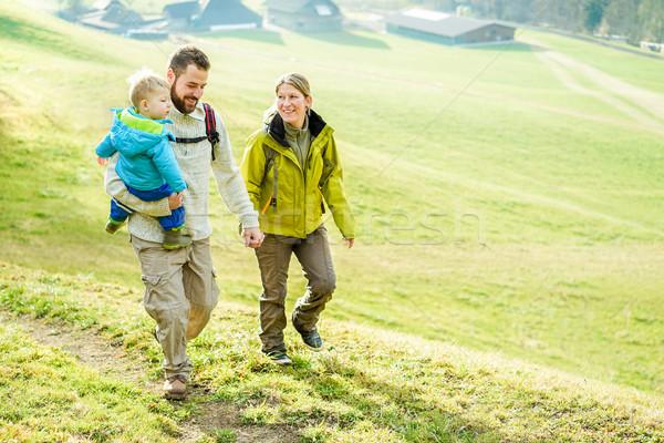 Happy family with little child doing trekking on switzerland mou Stock photo © DisobeyArt