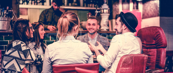 Group of young trendy friends chatting and laughing together ins Stock photo © DisobeyArt