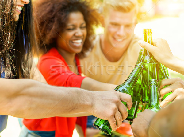 Happy diverse culture friends cheering with beer for summer barb Stock photo © DisobeyArt