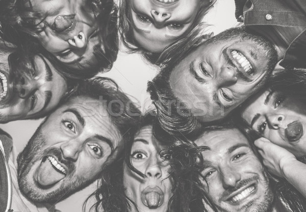 Bottom view of young friends making funny faces on camera - Happ Stock photo © DisobeyArt