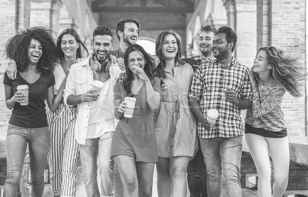 Boldog barátok sétál város központ kávé Stock fotó © DisobeyArt
