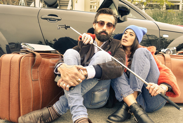 Hipster couple sitting on the street next their cabrio - Woman h Stock photo © DisobeyArt