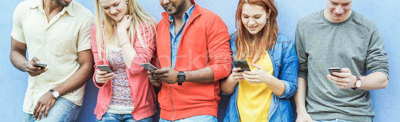 Group of diverse culture friends watching smart mobile phones -  Stock photo © DisobeyArt