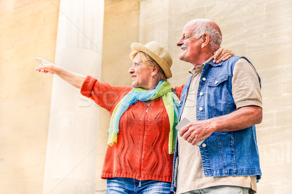 Senior couple pointing a monument during vacation - Active elder Stock photo © DisobeyArt