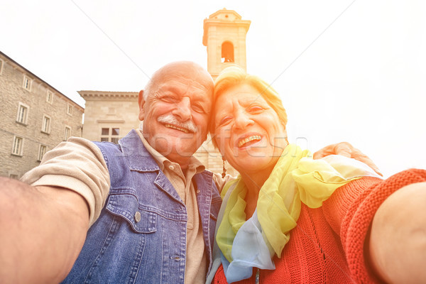 Senior couple taking a selfie in old town center - Two persons i Stock photo © DisobeyArt