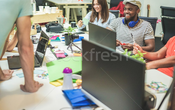 Young casually dressed co-workers planning a at startup - Trendy Stock photo © DisobeyArt