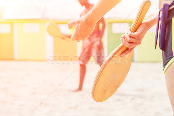 Group of young friends relaxing on sand at beach and playing wit Stock photo © DisobeyArt