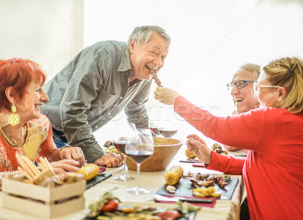 Happy senior friends having barbecue lunch at home - Old people  Stock photo © DisobeyArt