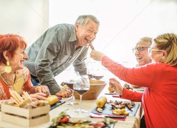 Boldog idős barátok barbecue ebéd otthon Stock fotó © DisobeyArt