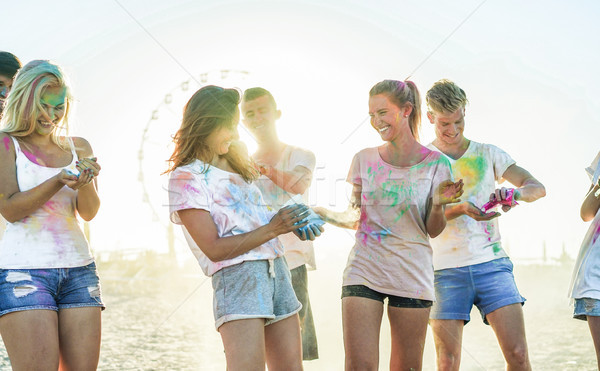 Happy friends making party at holi colors festival in summer tim Stock photo © DisobeyArt