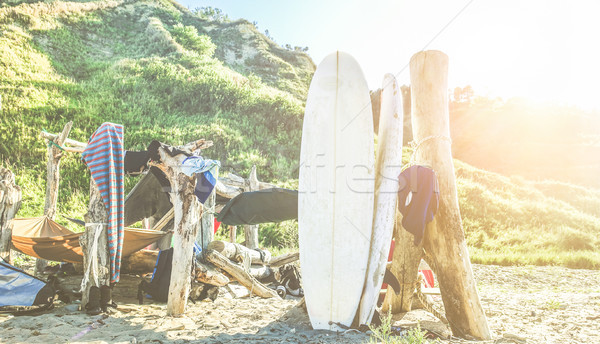 Surfers camp builded with sea woods , tents and hammocks - Surf  Stock photo © DisobeyArt