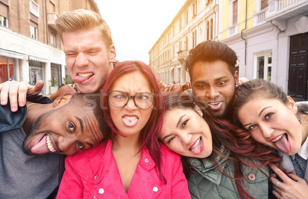 Multiracial best friends taking selfie outdoors in urban contest Stock photo © DisobeyArt