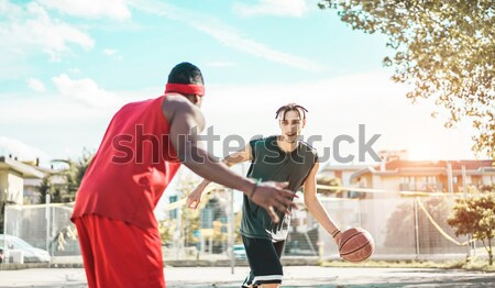Happy basketball players having fun on urban city basket camp in Stock photo © DisobeyArt