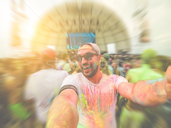 Genç çılgın adam toz renk Stok fotoğraf © DisobeyArt
