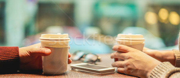 Young friends drinking coffee in paper take away cup - People ha Stock photo © DisobeyArt