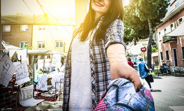 Pov view of young female seller giving short jeans in clothes we Stock photo © DisobeyArt