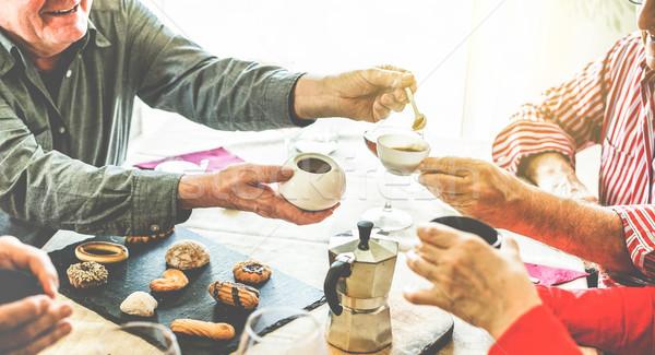 Group of senior people toasting italian style moka coffee after  Stock photo © DisobeyArt