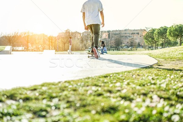 Young skater performing freestyle tricks in city park - Trendy g Stock photo © DisobeyArt