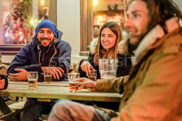 Feliz ricos amigos pub restaurante Foto stock © DisobeyArt