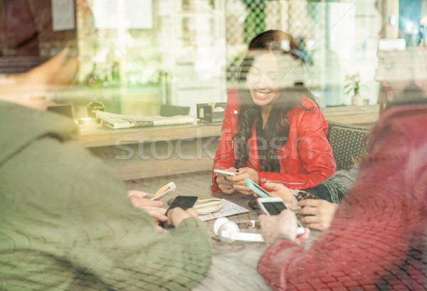 Happy friends waiting for coffee sitting in bar - Window reflect Stock photo © DisobeyArt