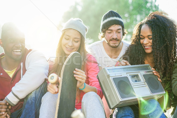 Happy multi ethnic friends having fun and listening music in ska Stock photo © DisobeyArt