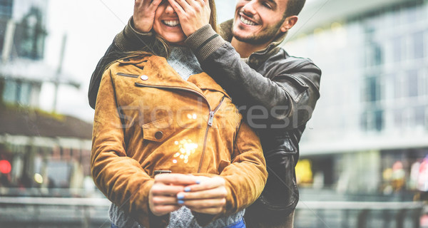 Happy boyfriend covering girlfriend eyes during winter holidays  Stock photo © DisobeyArt