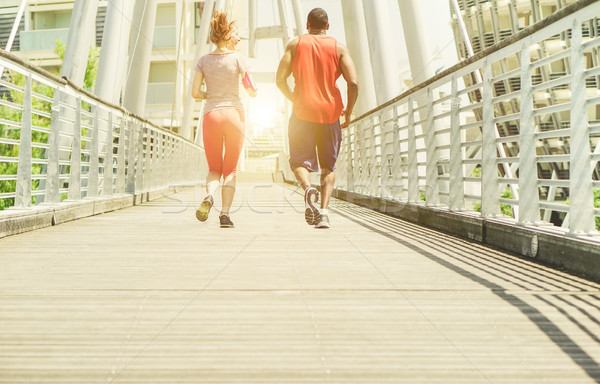 Two young athletes making jogging in a urban contest area outdoo Stock photo © DisobeyArt