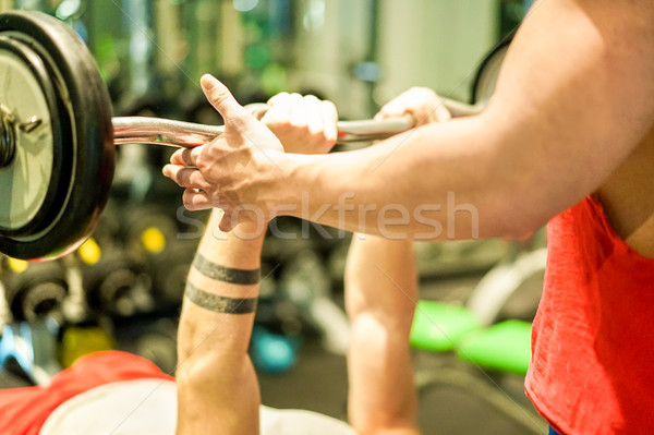 Athlete training with barbells inside american gym club with per Stock photo © DisobeyArt