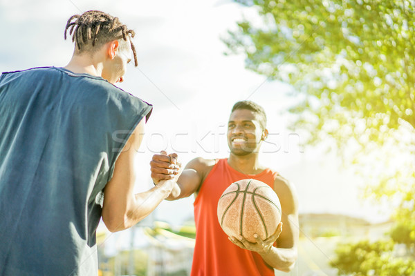 Baskeball players shakings hand before two on two game - Multira Stock photo © DisobeyArt