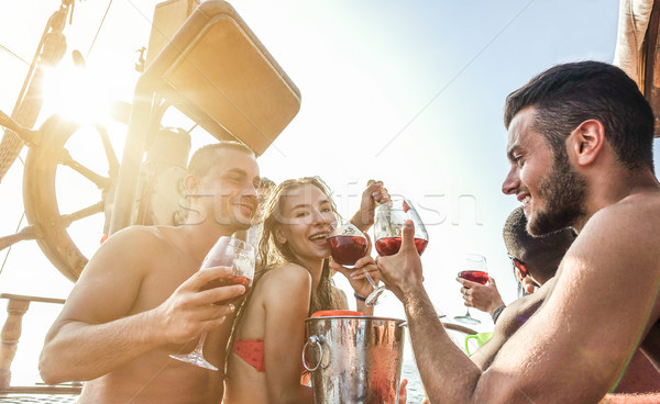 Happy friends having boat party outdoor with sangria and champag Stock photo © DisobeyArt