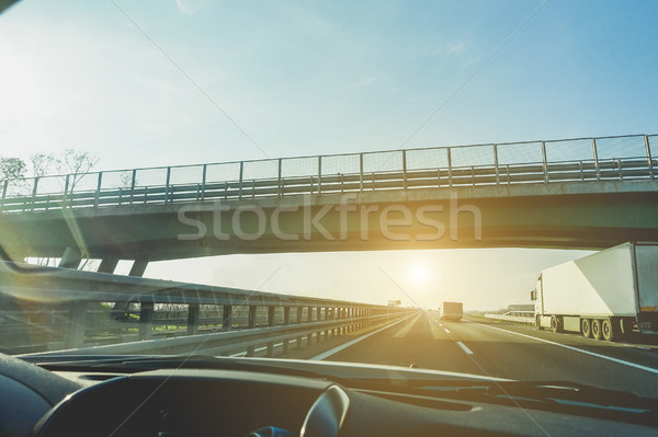 Car window view of trucks speeding in motorway under a overpass  Stock photo © DisobeyArt