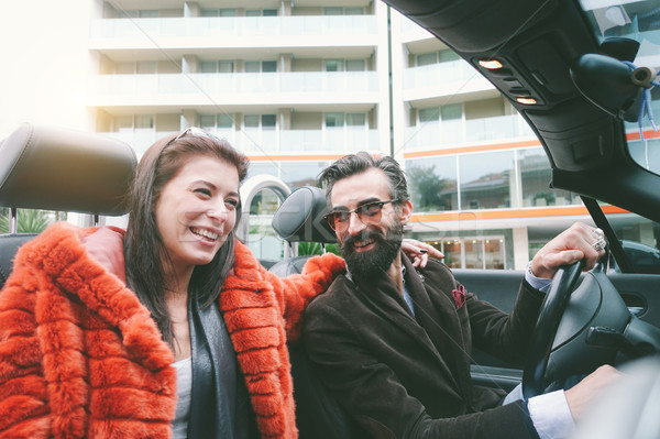 Happy couple having fun inside convertible car in holidays vacat Stock photo © DisobeyArt