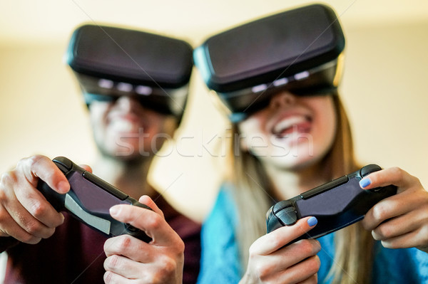Young funny couple playing video games virtual reality glasses i Stock photo © DisobeyArt