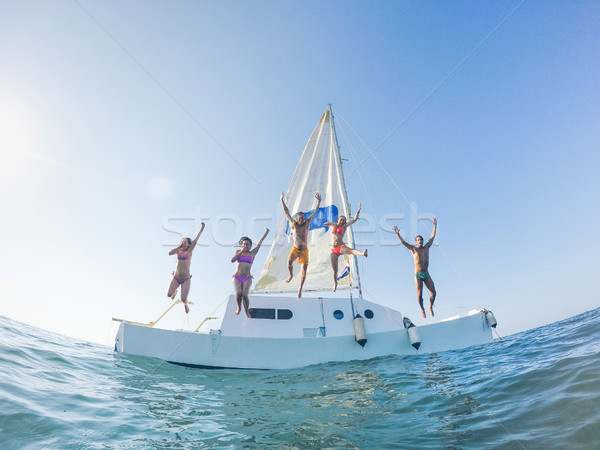 Boldog barátok ugrik el katamarán csónak Stock fotó © DisobeyArt