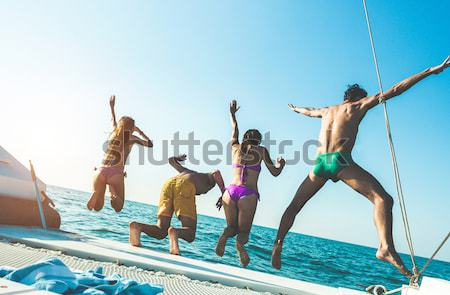 Happy young friends chilling in catamaran boat - Relaxed people  Stock photo © DisobeyArt