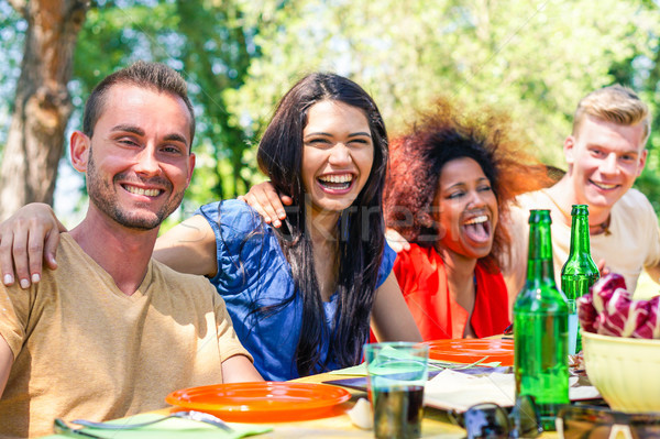 Multiracial group of friends eating and enjoying barbecue summer Stock photo © DisobeyArt
